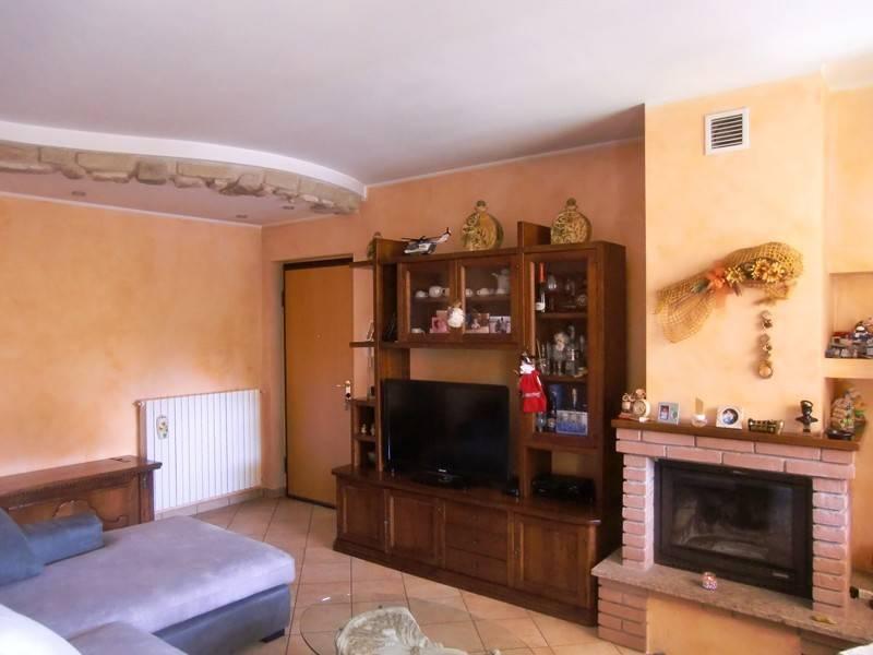 Appartamento con terrazzo, box e posto auto