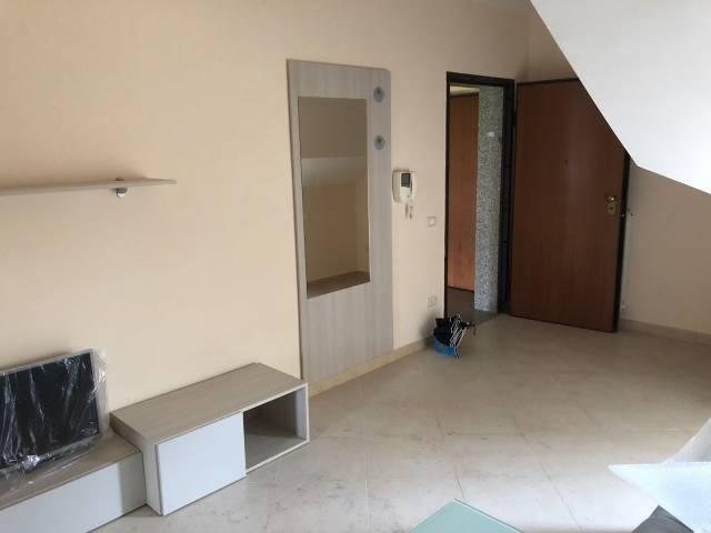 Attico / Mansarda in buone condizioni arredato in affitto Rif. 6565860