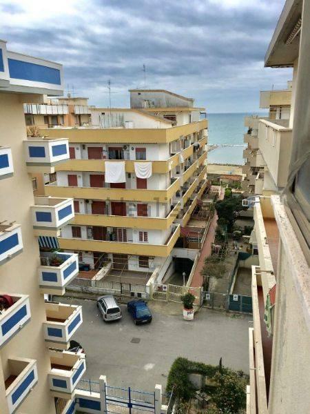 attico con balcone vista mare laterale arredato