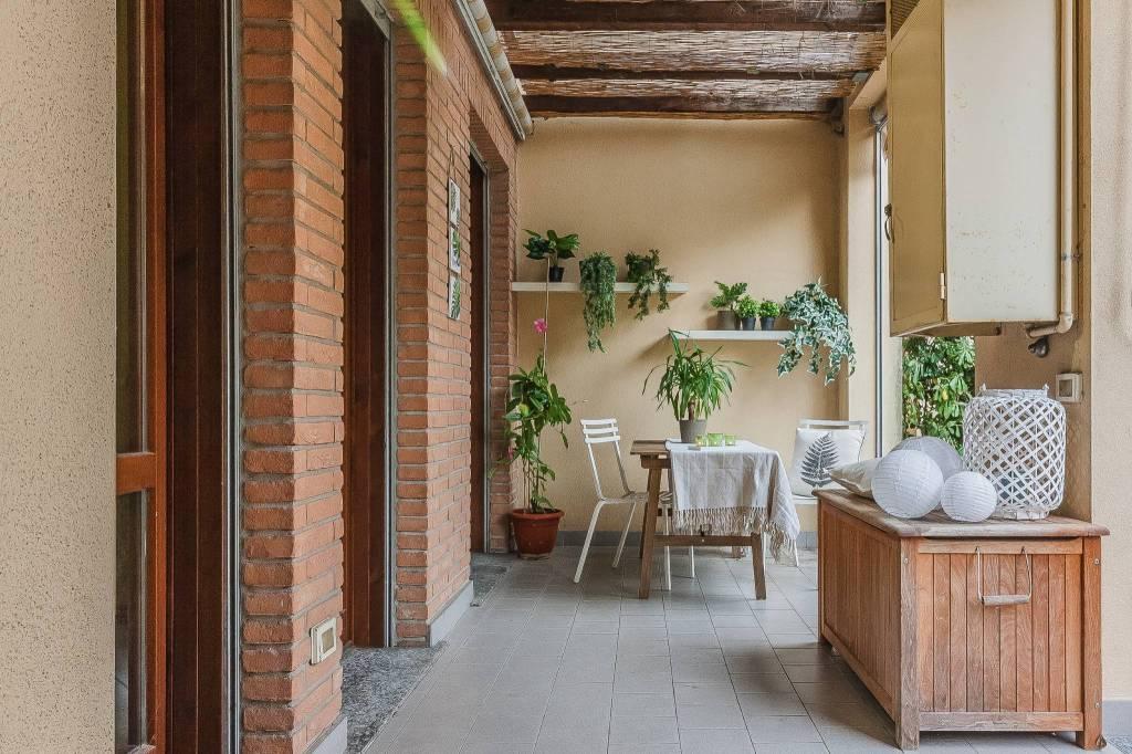 Trilocale con portico e giardinetto privato