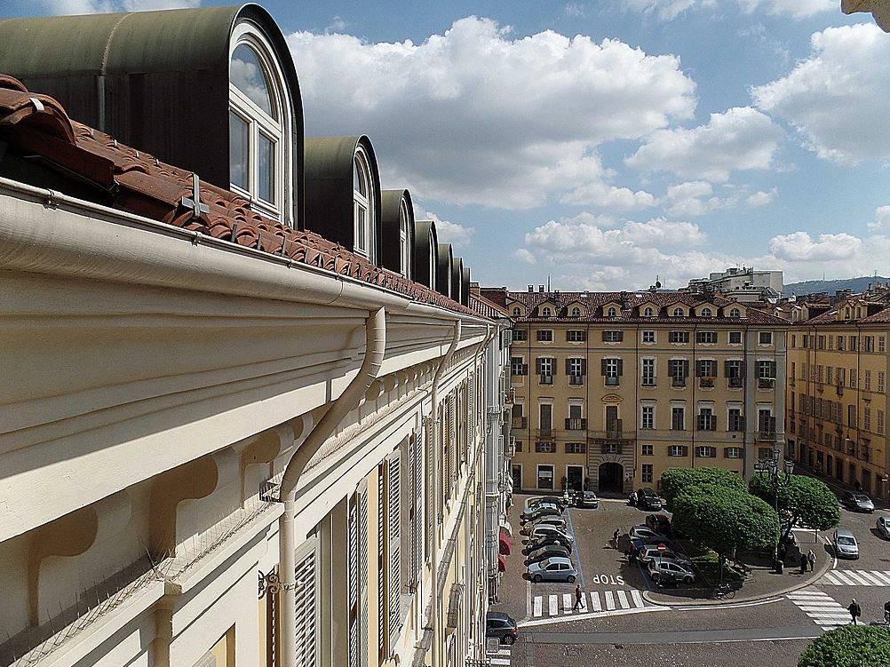 Foto 1 di Attico / Mansarda piazza Savoia 7, Torino (zona Centro)